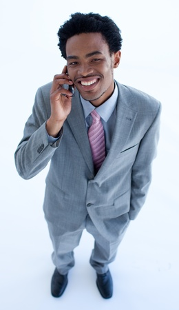 Smiling businessman speaking on a mobile phone photo