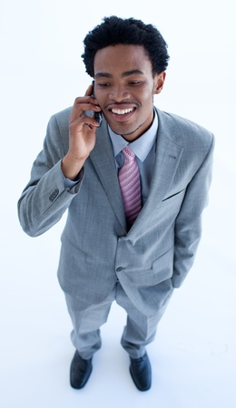 Afro-American businessman speaking on a mobile phone photo