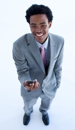 Afro-American businessman holding a mobile phone photo