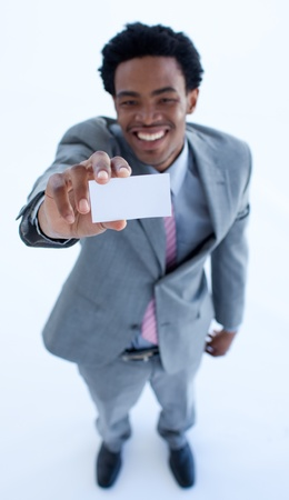 Smiling Afro-American businessman holding a business card photo