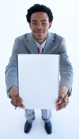 Businessman holding a big notebook photo