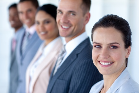 Attractive businesswoman with her team in a row