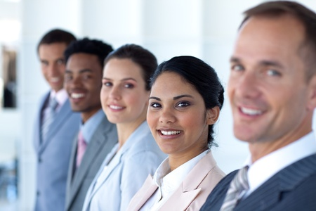 Beautiful businesswoman with her team in a line Stock Photo - 10074279