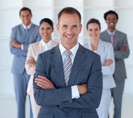 Business manager standing in office leading his team photo