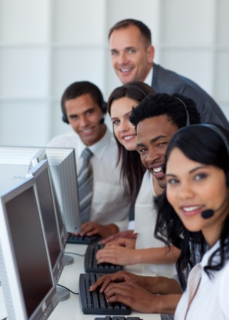 Business team and manager working in a call center photo
