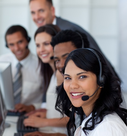 call center office: Portrait of a businesswoman in a call center with her team Stock Photo