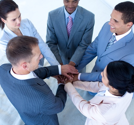 Multi-ethnic business team with hands together Stock Photo - 10073603