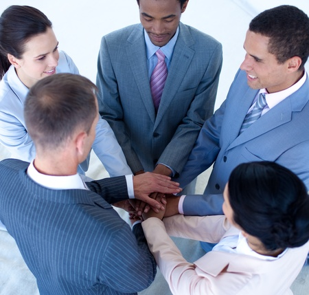 International business team with hands together Stock Photo - 10072777