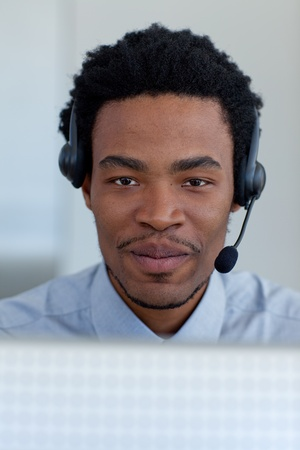 Portrait of Afro-American businessman in a call center photo
