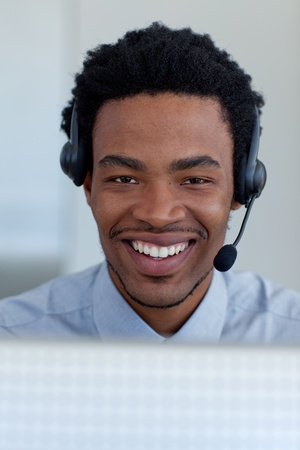 Portrait of a smiling Afro-American businessman in a call center photo
