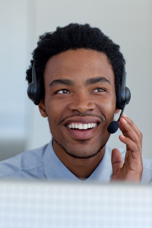 Afro-American businessman in a call center photo