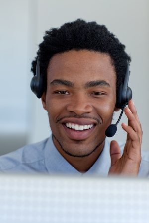telephonist: Afro-American young businessman in a call center Stock Photo