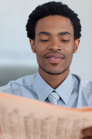 Afro-American businessman reading a newspaper Stock Photo - 10074712