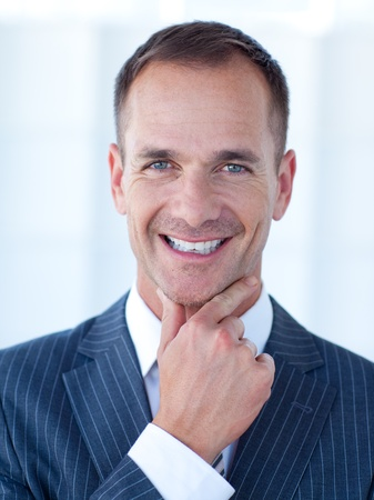 Portrait of a smiling attractive businessman Stock Photo - 10074235