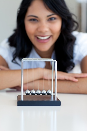 woman hanging toy: Businesswoman playing with kinetic balls