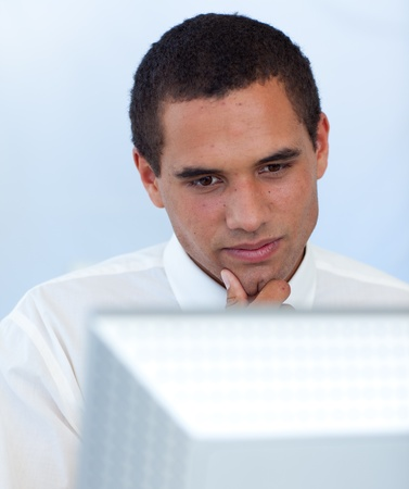Thoughtful businessman working with a computer Stock Photo - 10072634