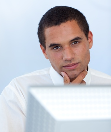Attractive businessman working with a computer Stock Photo - 10072442