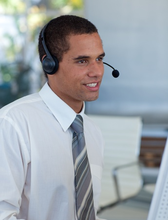 Hispanic businessman working in a call center photo