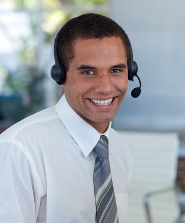 Attractive businessman working in a call center photo