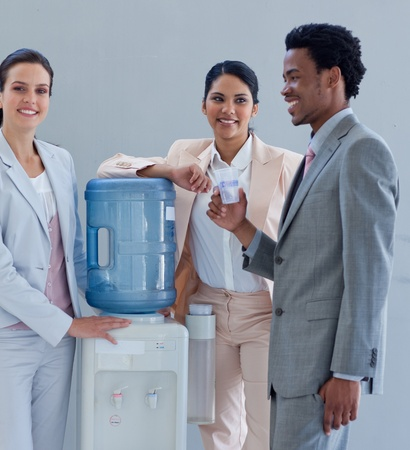 Business people with a water cooler in office photo