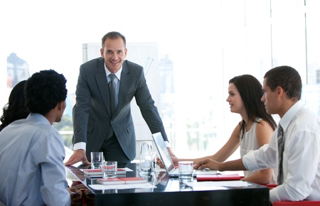 businessmeeting: Business people talking about a new business plan Stock Photo