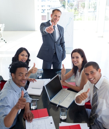 businessmeeting: Business people in a meeting with thumbs up