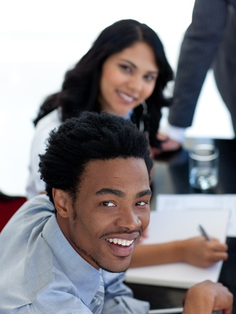businessmeeting: Smiling Afro-American businessman in a meeting Stock Photo