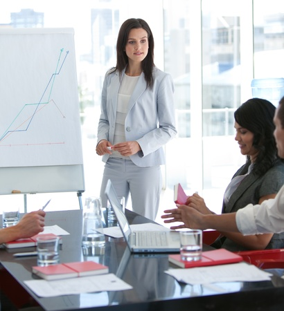 Businesswoman talking to her colleague in a presentation photo