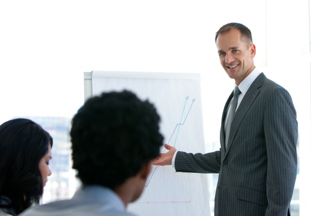Manager giving a presentation to his team Stock Photo - 10071566