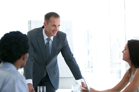 Manager talking to his team in a presentation Stock Photo - 10072178
