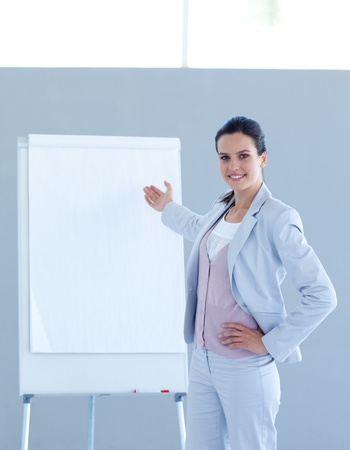 Businesswoman pointing to a whiteboard photo