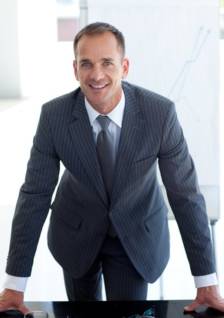 Senior businessman giving a presentation photo