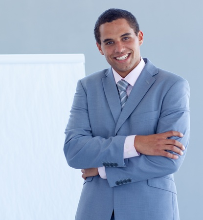 Smiling businessman giving a presentation Stock Photo - 10071910