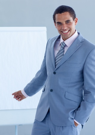 Young businessman pointing at a whiteboard photo