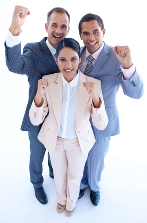 Happy business team celebrating a success with arms up photo