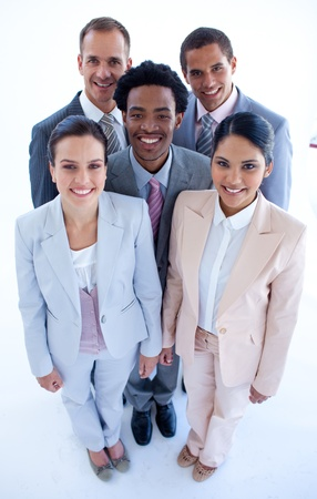 Happy multi-ethnic business team smiling at the camera photo