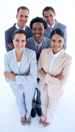 Happy international business team smiling at the camera Stock Photo - 10073856