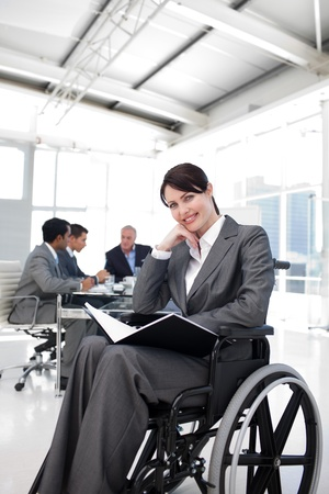 handicapped person: Portrait of a smiling businesswoman in a wheechair