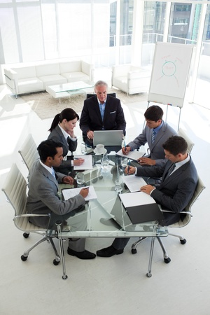 High angle of a senior manager in a meeting with his team photo