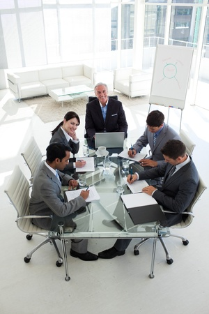 High angle of a business team sitting around a conference table