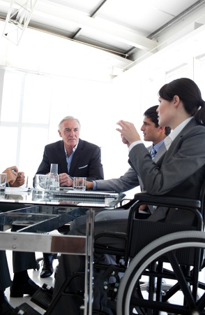 handicapped accessible: Attractive businesswoman in a wheelchair during a meeting  Stock Photo