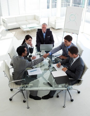 deal in: Businessmen closing a deal in a meeting