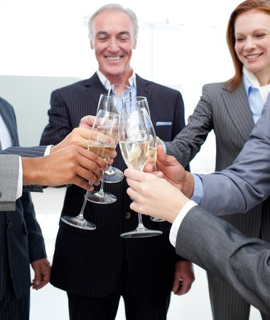 Cheerful business team celebrating a success  photo