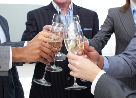 Close-up of business team toasting with Champagne photo