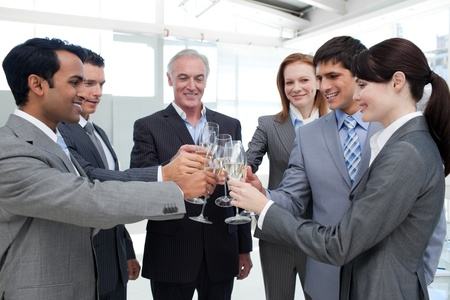 Cheerful business team toasting with Champagne  photo