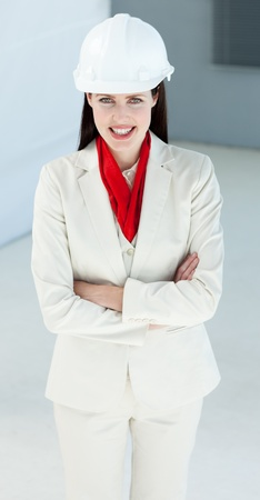 Attractive female architect with folded arms photo