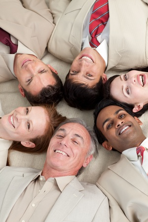 Multi-ethnic business team lying in a circle  Stock Photo - 10094740