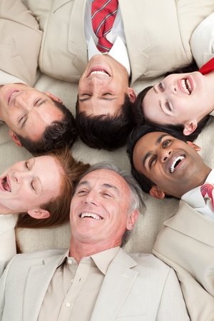 Laughing Business team lying in a circle photo