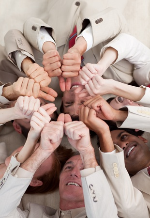 Multi-ethnic business people with thumbs up lying on the floor photo