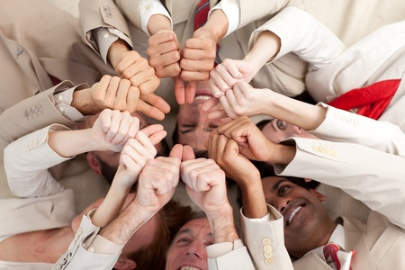 Successful business team with thumbs up lying in a circle photo